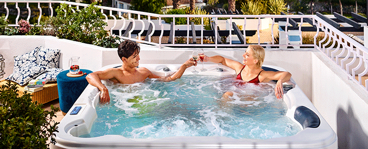 Man and woman on the Four Seasons Fairways jacuzzi